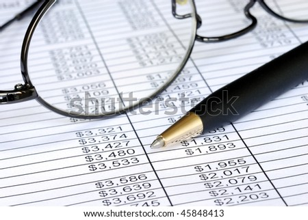 Check the numbers on the spreadsheet with shallow DOF - stock photo