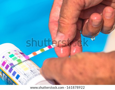 Check the pH of a private swimming pool - stock photo
