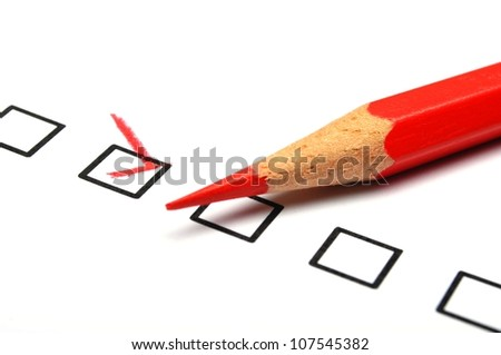checkbox and red pen showing customer service survey or satisfaction concept to improve sales - stock photo
