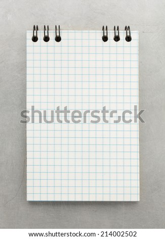 checked notebook at metal background texture - stock photo