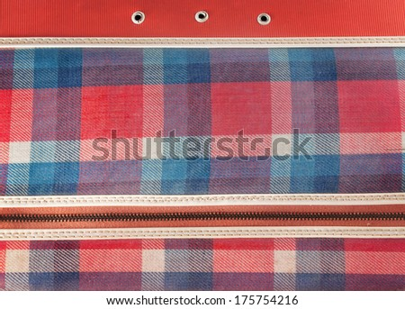 Checkered bag with detail accessories texture. - stock photo