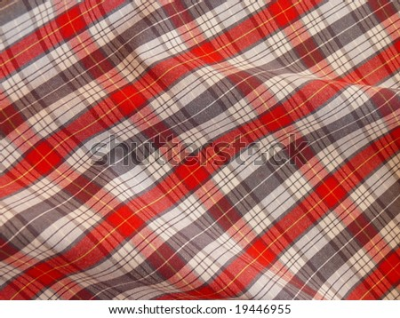 Checkered fabric closeup. More fabrics in my port. - stock photo
