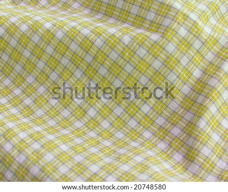 Checkered fabric closeup. Yellow. More of this motif & more fabrics in my port. - stock photo