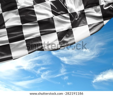 Checkered flag on a beautiful day background - stock photo