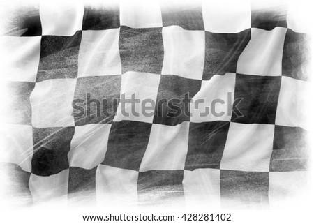 Checkered flag on plain background - stock photo