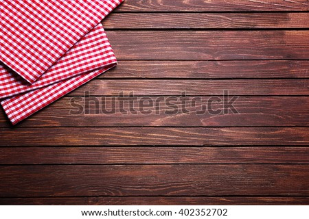 Checkered napkin on wooden background - stock photo