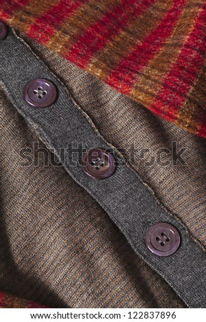Checkered scarf and brown clothes isolated on - stock photo