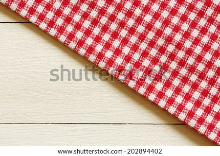 Checkered Tablecloth On The White Wooden Background