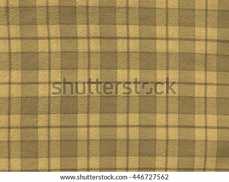 Checkered tablecloth texture useful as a background vintage sepia