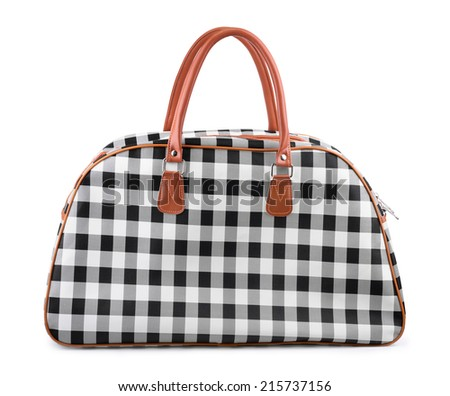 Checkered travel bag isolated on white - stock photo