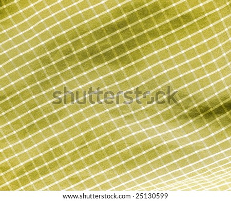 Checkered yellow spring textile closeup. More of this motif & more fabrics in my port. - stock photo