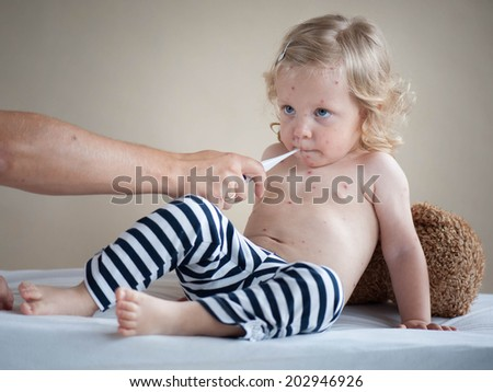 Checking baby's temperature  - stock photo