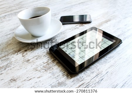 Checking monthly activities and appointments at the office in the tablet