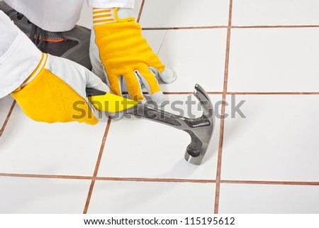 checking old tiles base with hammer