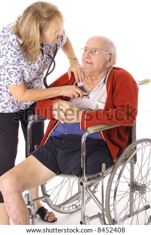 checking seniors heartbeat - stock photo