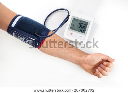 Checking the blood pressure with a modern digital equipment - stock photo