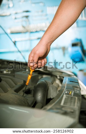 Checking the car oil - stock photo