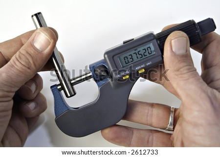 Checking the diameter of a pin with a micrometer