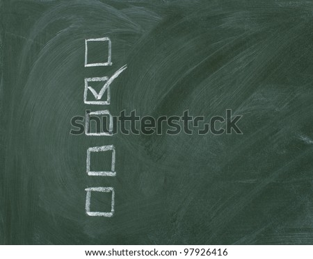 Checklist at the blackboard with copy space - stock photo