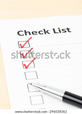 Checklist paper with tick mark and pen - stock photo