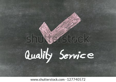 "checkmark symbol and word""Quality service"" - stock photo"
