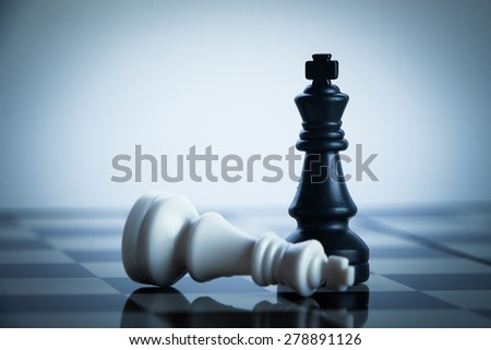 Checkmate black chess defeats white king on the chess board. - stock photo