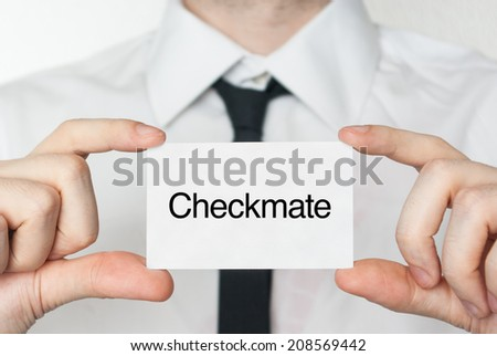 Checkmate. Businessman in white shirt with a black tie showing or holding business card  - stock photo