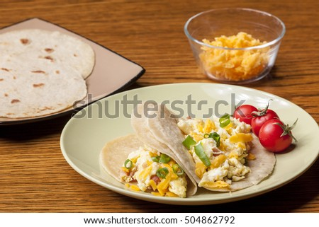 Cheddar cheese and breakfast burritos with hand made tortillas.
