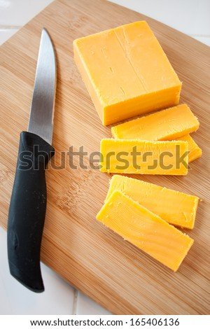 Cheddar Cheese Block and Slices - stock photo