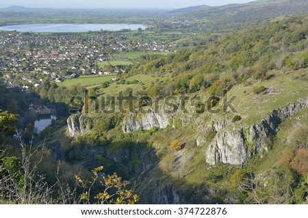 Cheddar Gorge viewed from Cheddar Cliffs, with Cheddar Reservoir, Brent Knoll & Crook Peak in the distance - stock photo