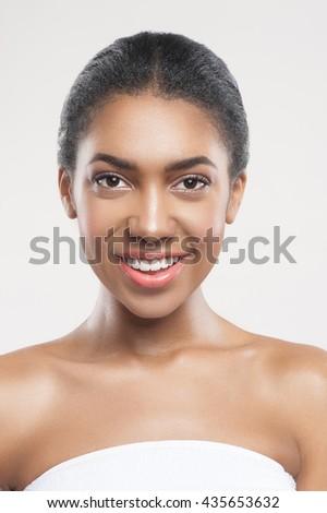 Cheerful afircan girl caring of her skin - stock photo