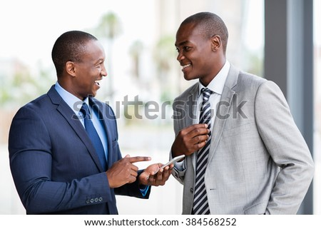 cheerful african american business team using mobile phone in office - stock photo