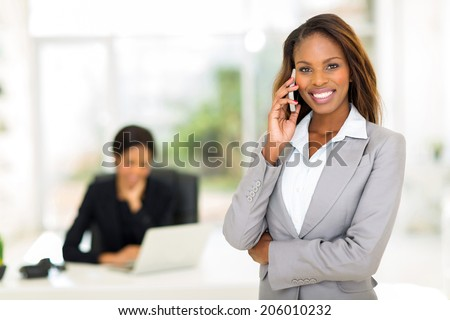 cheerful african american businesswoman talking on smart phone - stock photo