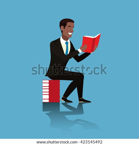 Cheerful African American in a brown suit and blue tie is with a book in his hands. Student sitting on a pile of books. Businessman sitting and holding an open book in his hands. Teacher with a book - stock photo