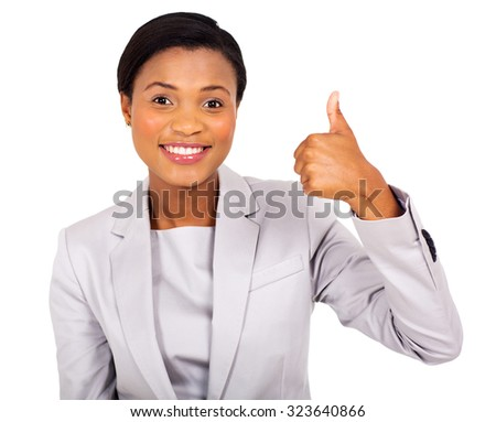 cheerful african business executive giving thumb up - stock photo
