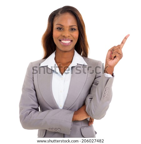 cheerful african businesswoman pointing empty space on white background - stock photo