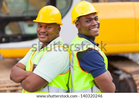 cheerful afro american mine workers at mining site - stock photo