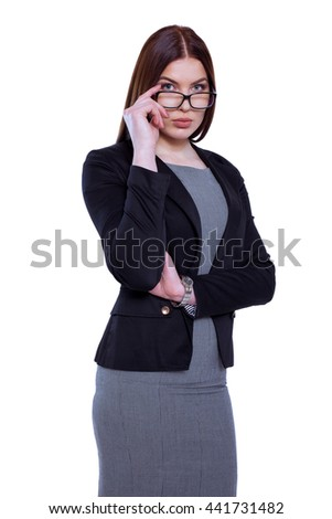 Cheerful and confident. Attractive businesswoman in glasses looking at camera while standing against white background - stock photo