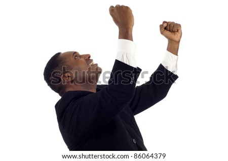 Cheerful and excited ertrepreneur, African American businessman celebrating his success with arms raised and looking up isolated white background - stock photo