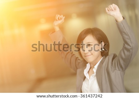 Cheerful and exciting business woman of Asian inside of modern buildings. - stock photo