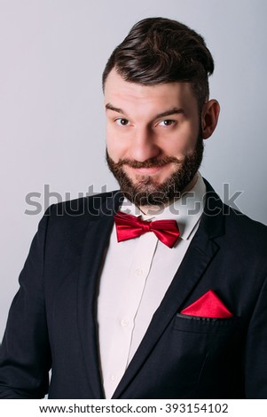 Cheerful and friendly young showman with a beard on a white background