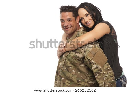 Cheerful army man with his wife embracing against white background - stock photo