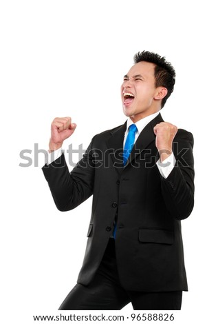Cheerful asian business man with arms raised in success isolated on white background