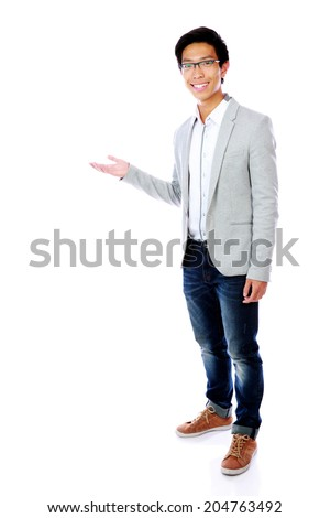 Cheerful asian man with arm out in a welcoming gesture - stock photo