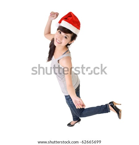 Cheerful Asian woman dancing with Christmas hat. - stock photo