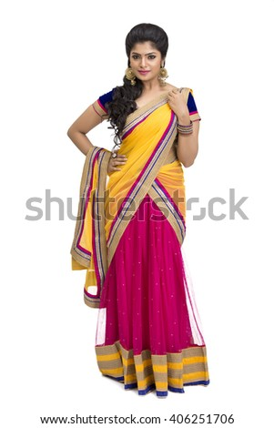 Cheerful attractive Indian young girl in traditional half sari on white. - stock photo
