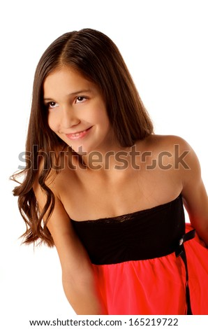 Cheerful Attractive Teen Girl with Long Beautiful Hair in Black and Pink Dress  isolated on white background - stock photo