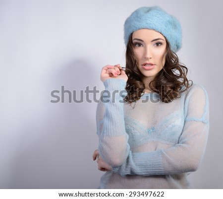 Cheerful attractive young girl looking at camera, in warm clothes, toned - stock photo