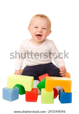 cheerful baby boy playing with colorful blocks isolated on white background - stock photo