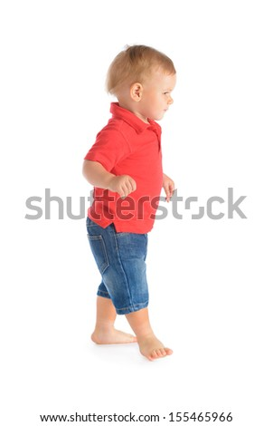 Cheerful baby boy walking isolated over white background - stock photo